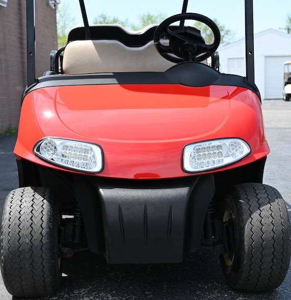 The front view of a used red E-Z-GO RXV golf cart parked at Carts & Parts in Union City, IN.