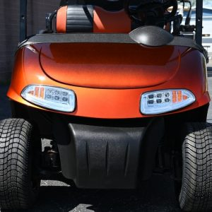Front view of a used orange electric E-Z-GO RXV golf cart parked at Carts & Parts in Union City, IN.