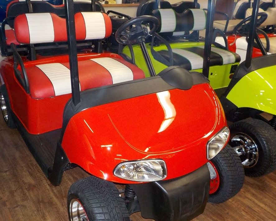 New golf carts in red and yellow at Carts & Parts in Union City, IN.