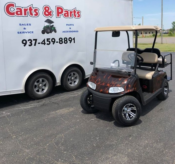 Fire-flamed golf cart in front on Parts & Carts truck in Union City, IN.