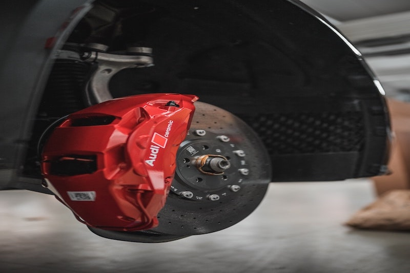 A red golf cart brake pad.