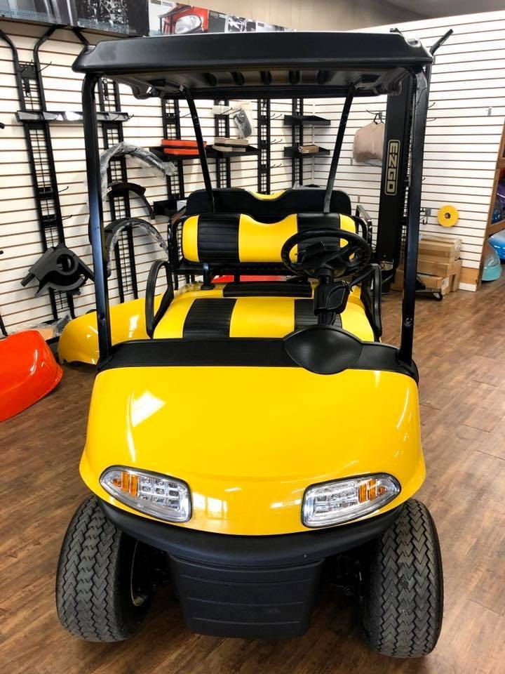 Yellow golf cart inside Carts & Parts in Union City, IN.