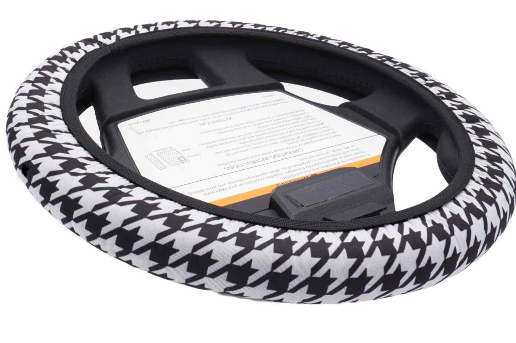 A golf cart steering wheel with cover