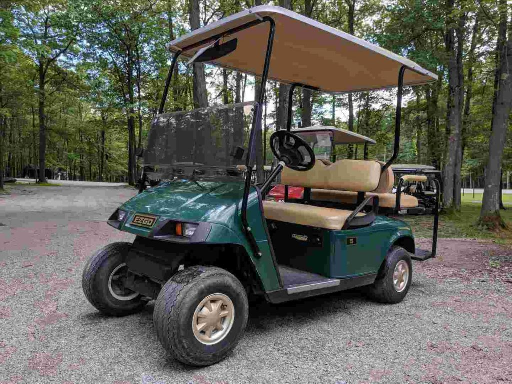 A golf cart that is parked outside