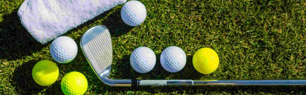 Essential golf supplies - a golf club and golf balls